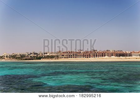 Egypt. Hurghada. Landscape From The Sea Vidneetsya Horizon Line With An Unfinished Hotel.