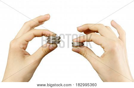Close Up. Hands Compare Two Piles Of Coins Of Different Sizes, Indicating The Return On Investment.