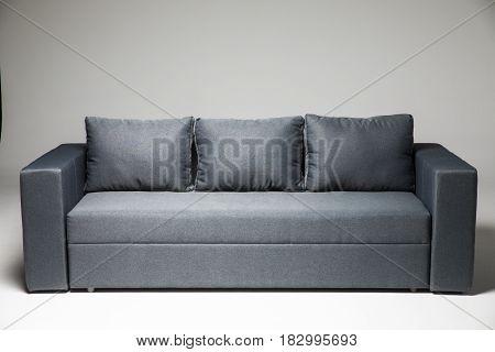 Grey Sofa Isolated On Grey Background