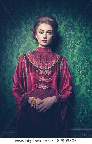 Gorgeous woman dressed vintage clothes in retro interior. Rococo period. Luxury and high class