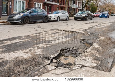 Montreal, Canada - 21 April 2017: Large Unrepaired Pothole On Gilford Street