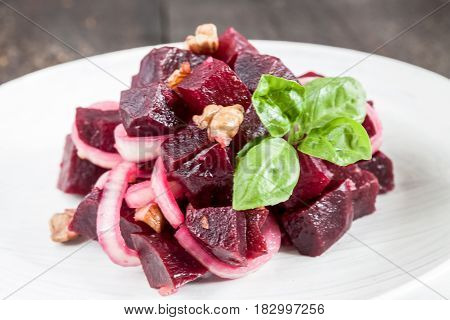 Vegetarian Lean Lettuce From Beet, Onion, Walnuts, Serving On A White Plate On A Dark Background. Cl