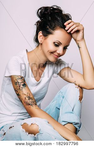 Fashion photo of young smiling model woman on white background. Girl posing. Studio photo.