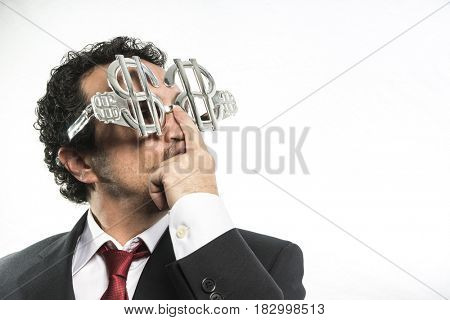 Success, Businessman with suit and glasses in the form of dollars. Expressions of stress, overwhelm and craving for money
