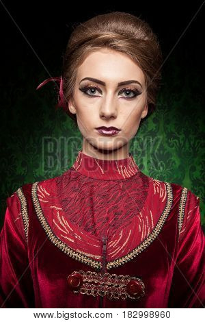 Portrait of gorgeous woman dressed vintage clothes in retro interior. Rococo period. Luxury and high class