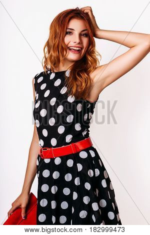 Fashion photo of redhair smiling young model woman on white background. Girl posing. Studio photo.
