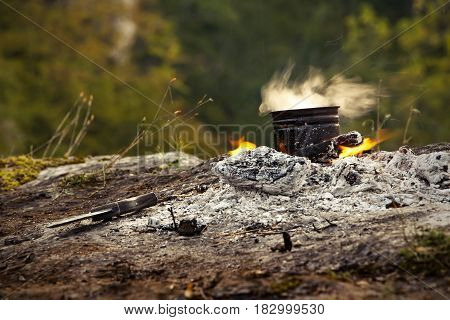 Early morning fire to prepare tea on the edge of the canyon