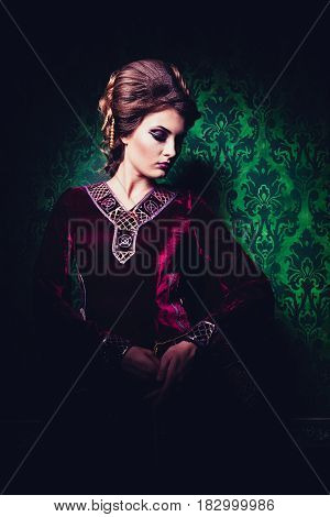 Gorgeous woman dressed in luxury vintage clothes in retro interior. Rococo period. Luxury and high class
