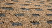 Asphalt Shingles Soft Focus Photo. Close up view on Asphalt Roofing Shingles Background. Roof Shingles - Roofing Construction Roofing Repair. poster