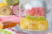 Multicolored fruit marmalade sweets of different forms in sugar poster