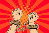 Freedom arms breaking the chains of slavery pop art retro style. Human rights. The struggle for freedom. Prisoner breaks the chain. Vector illustration. poster