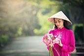 Beautiful woman with Vietnam culture traditional Ao dai is famous traditional costume poster