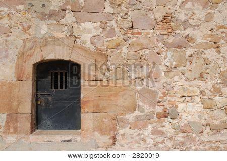 Locked Door In Stone Wall