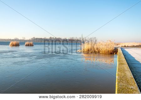 Large Lake In The Dutch National Park Biesbosch, North Brabant. A Thin Layer Of Ice Is Over Most Of
