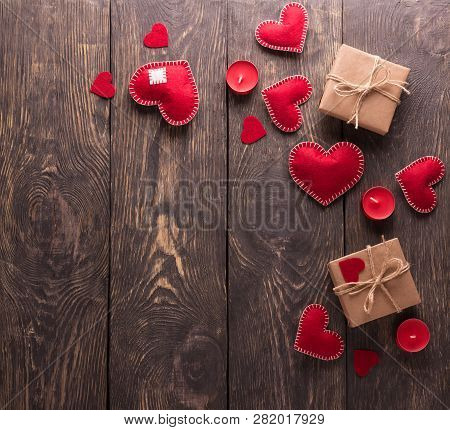Composition For Valentine's Day. Bright Red Heart Made By Hand, Gifts In Kraft Paper