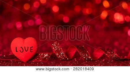 Bright Heart With The Inscription Love, Shining Red Ribbon On A Bright Red Background
