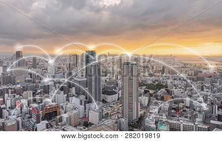 Network Connection Technology In The City, Osaka City In Sunset