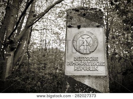 Border Pillar Of The Former Inner German Border With The Emblem Of The Gdr In The Forest In The Harz