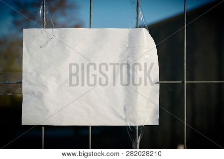 Sheet Of Paper With Copy Space On A Fence