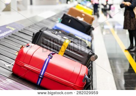 Baggage Luggage On Conveyor Carousel Belt At Airport Arrival