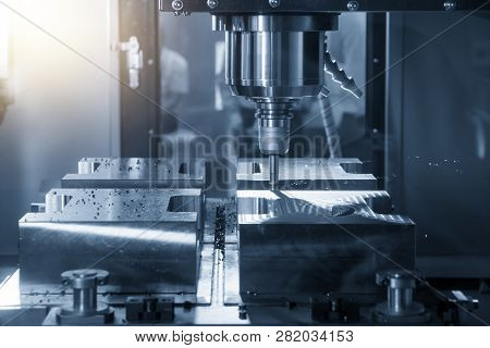 The Cnc Milling Machine Cutting The Mould Part With The Index-able Radius End Mill Tool In Roughing