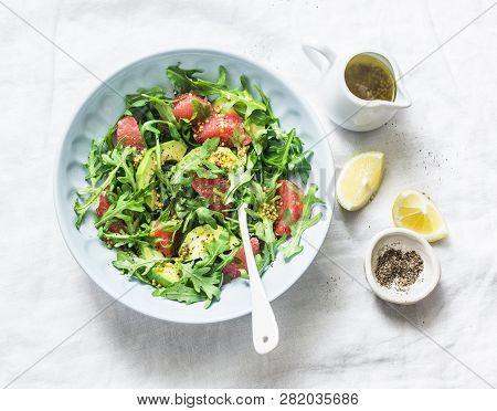 Avocado, Grapefruit, Rocket Salad With Mustard Olive Oil Salad Dressing On Light Background, Top Vie