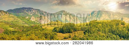 Gorgeous Panorama Of Countryside At Sunset In Evening Light. Beautiful Landscape Of Romania. Rural A