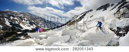 Extreme Cyclist And Mountain Biking In The Icefall