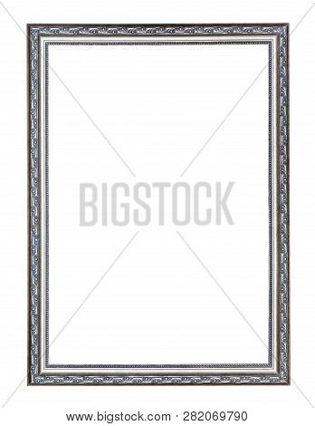 Empty Narrow Silver Carved Wooden Picture Frame With Cut Out Canvas Isolated On White Background