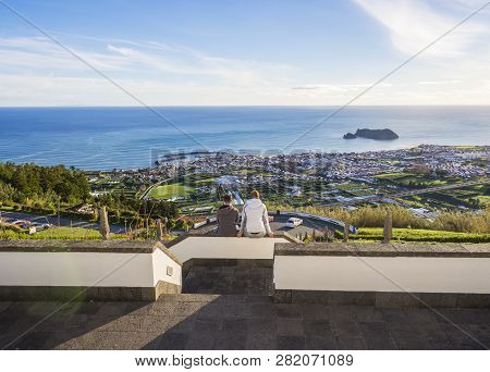 Portugal, Vila Franca Do Campo, Sao Miguel, Azores, December 20, 2018: Young Couple Sitting On Stair