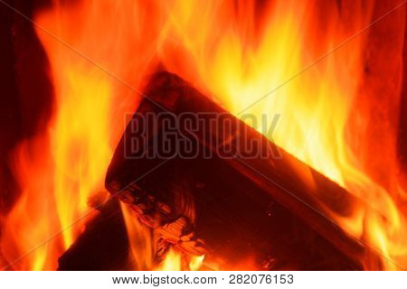 Close-up Of Logs In A Fire. Firewood Is Burning In A Stove