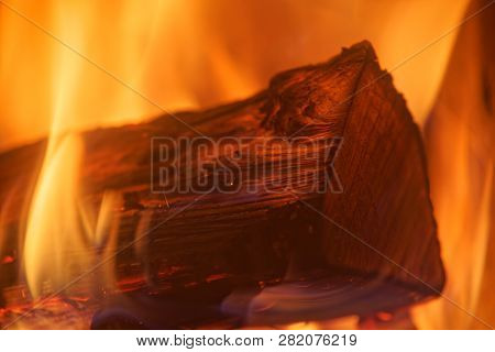 Close-up Photo Of Single Log In Yellow Red Fire Flames
