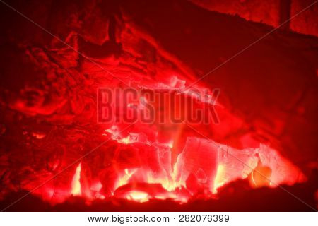 Abstract Image Of Red Glowing Wood And Flames In A Stove