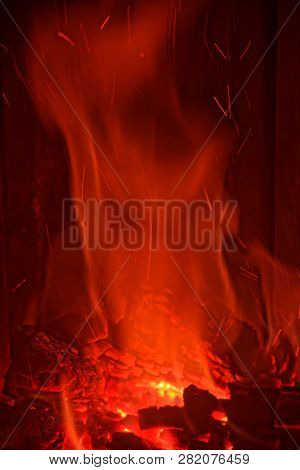 Red Fire Flames From Burning Wood In A Fireplace At Home