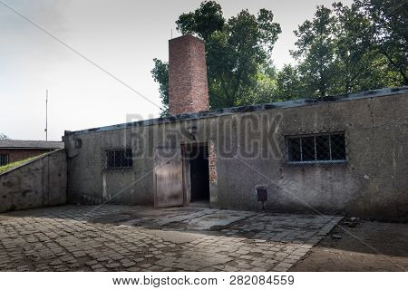 Auschwitz, Poland - July 2017: The Entrance In The Gas Chamber And Crematorium In Auschwitz Camp I.