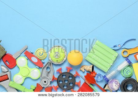 Variety Of Toys On Blue Surface, Top View With Copy Space