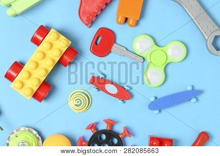 Variety Of Toys On Blue Surface, Top View