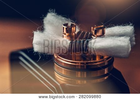 Rda - Vape Device With Coils And Japanese Organic Cotton For Vaping, Close Up. E-cigarette Or E-cig