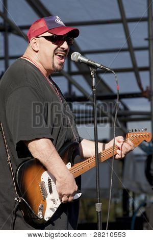 CLARK, NJ - SEPT 18: Lead singer and guitar player Pat DiNizio of the band The Smithereens performs at the Union County Music Fest on September 18, 2011 in Clark, NJ.