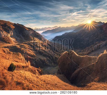 Mountains In Fog At Beautiful Sunset In Autumn. Dolomites, Italy. Landscape With Alpine Mountain Val