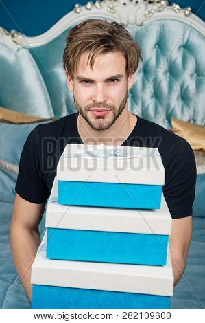 Man handsome lover and gift. Surprise for sweetheart. Gifts for darling. Romantic surprise. Birthday morning. Valentines day celebration. Sexy surprise for female. Man in luxury bedroom with gift box. poster