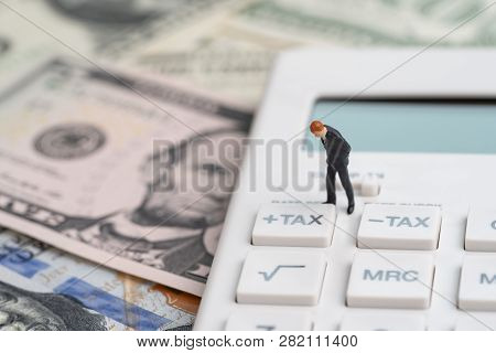 Tax Calculation Or Tax Refund For Individual Or Company Concept, Miniature Businessman Leader Standi