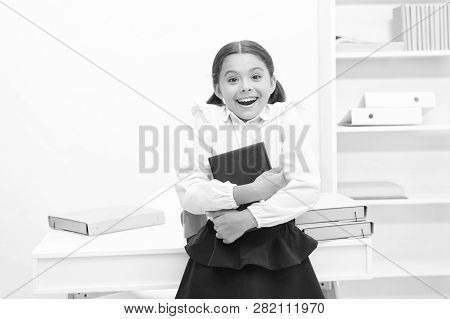 Information Concept. Happy Child Got Information From Reading. Child Hold Book With Latest Informati