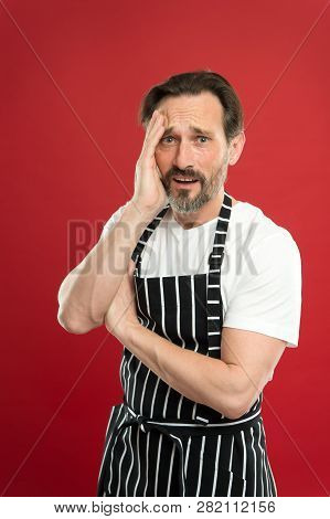 Lot Of Work. Confident Mature Handsome Man In Apron Red Background. He Might Be Baker Gardener Chef