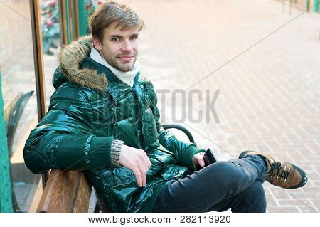 Communication Concept. Hipster Use Smartphone On Winter Day. Man Handsome Hold Smartphone. Guy Sit B