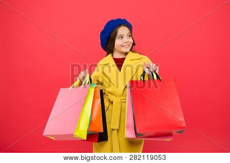 Obsessed With Shopping. Girl Cute Kid Hold Shopping Bags. Get Discount Shopping On Birthday Holiday.