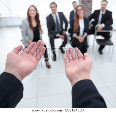 business partners listen to a colleague's speech