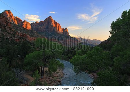 Photographing The Watchman, The Most Iconic Peak In Zion National Park. During Sunset, The Sandstone