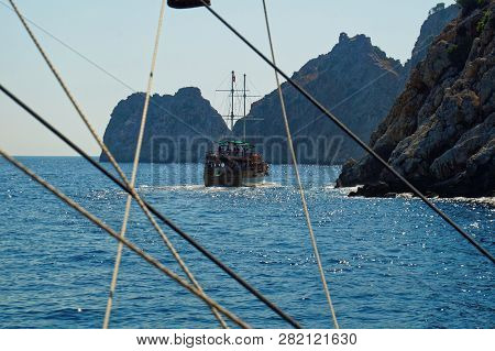 Scenic View Through The Cordage Of A Touristic Sail Boat In The Turquoise Waters Of Mediterranean Se