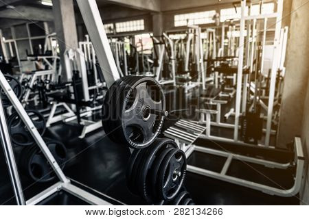 Weights Lifting Rack In Club Fitness Gym., Bodybuilder Equipment Barbell For Shoulders Muscle Exerci